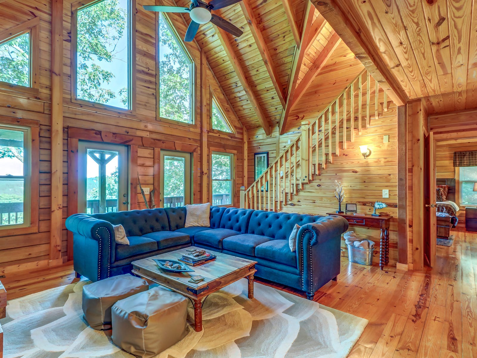 vacation cabin in ranger, ga with soft blue chesterfield couch