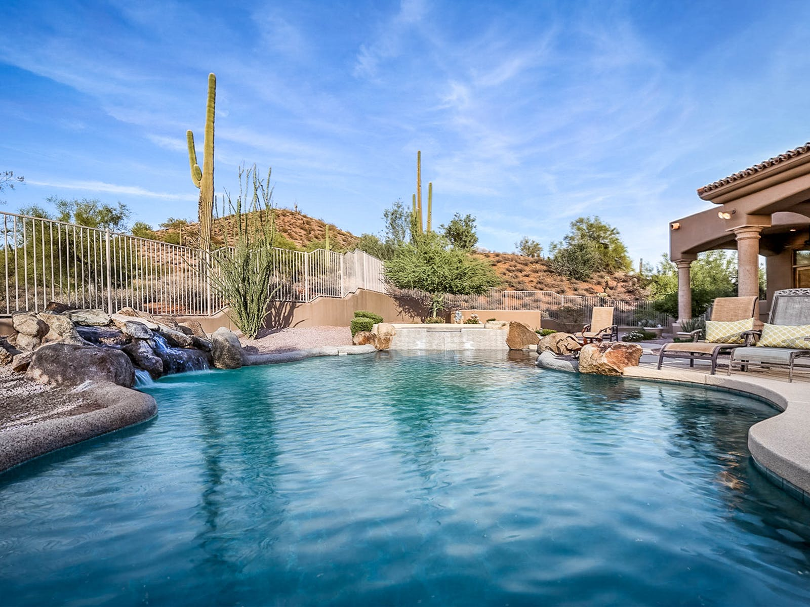 outdoor pool with gorgeous desert landscaping located in Scottsdale, AZ