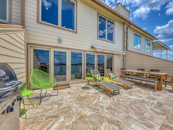 comfy outdoor dining area, lounge and modern bistro seating of horseshoe bay, tx vacation home