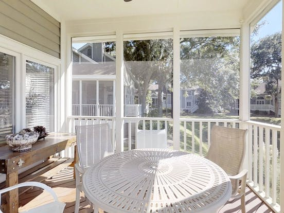Hilton Head pet-friendly vacation rental back porch with table and seating