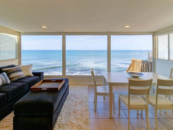 Vacation rental living area with ocean views in San Diego