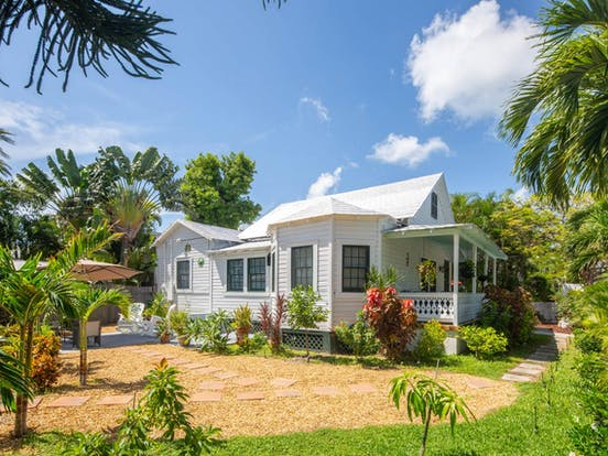 Key West, FL bungalow surrounded by greenery