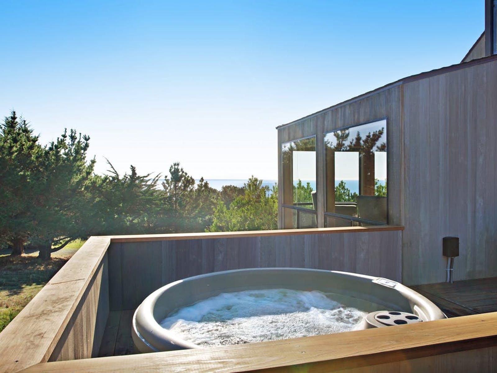 outdoor hot tub with coastal view in Sea Ranch, CA