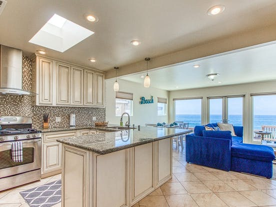 vacation rental kitchen with adorable backsplash and ocean views in San Diego, CA