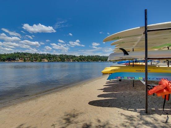 pine mountain lake, ca with kayaks and SUP on the beach