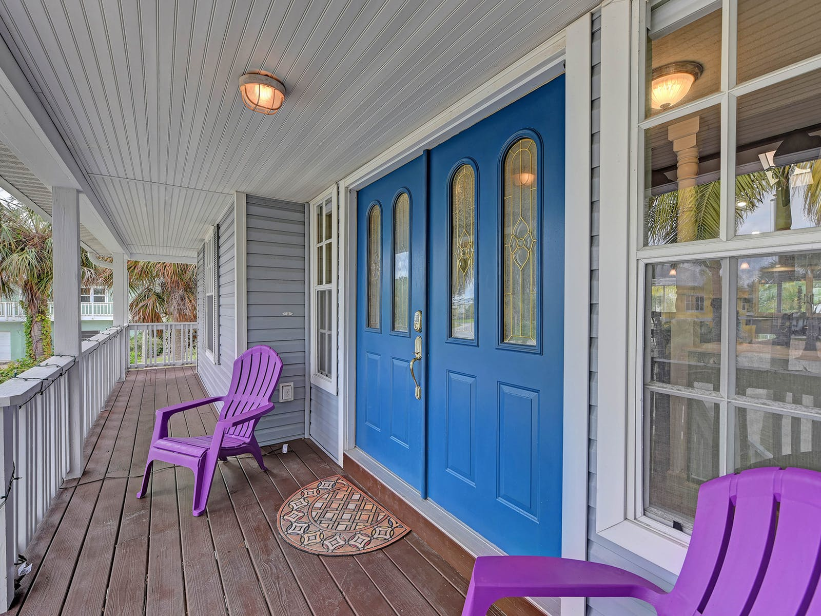 large blue double doors of vacation home in holmes beach, fl
