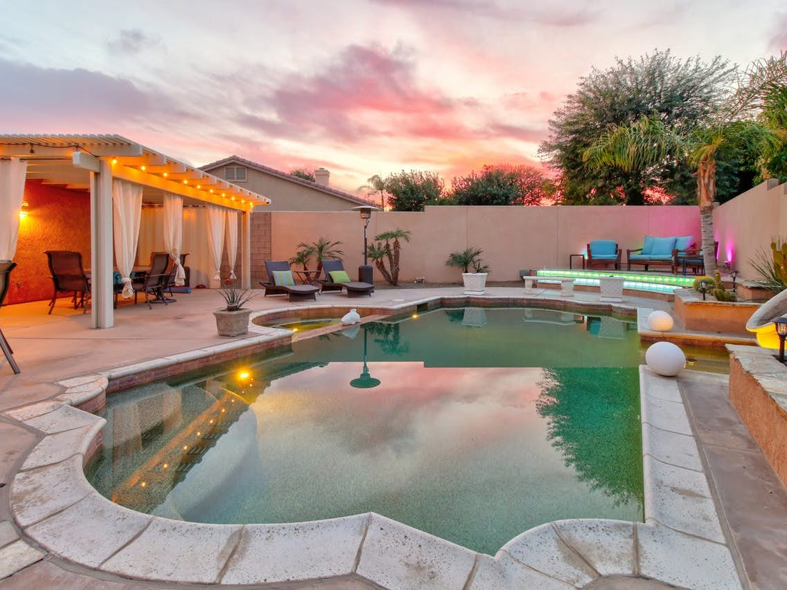 Vacation rental outdoor pool and patio in Indio