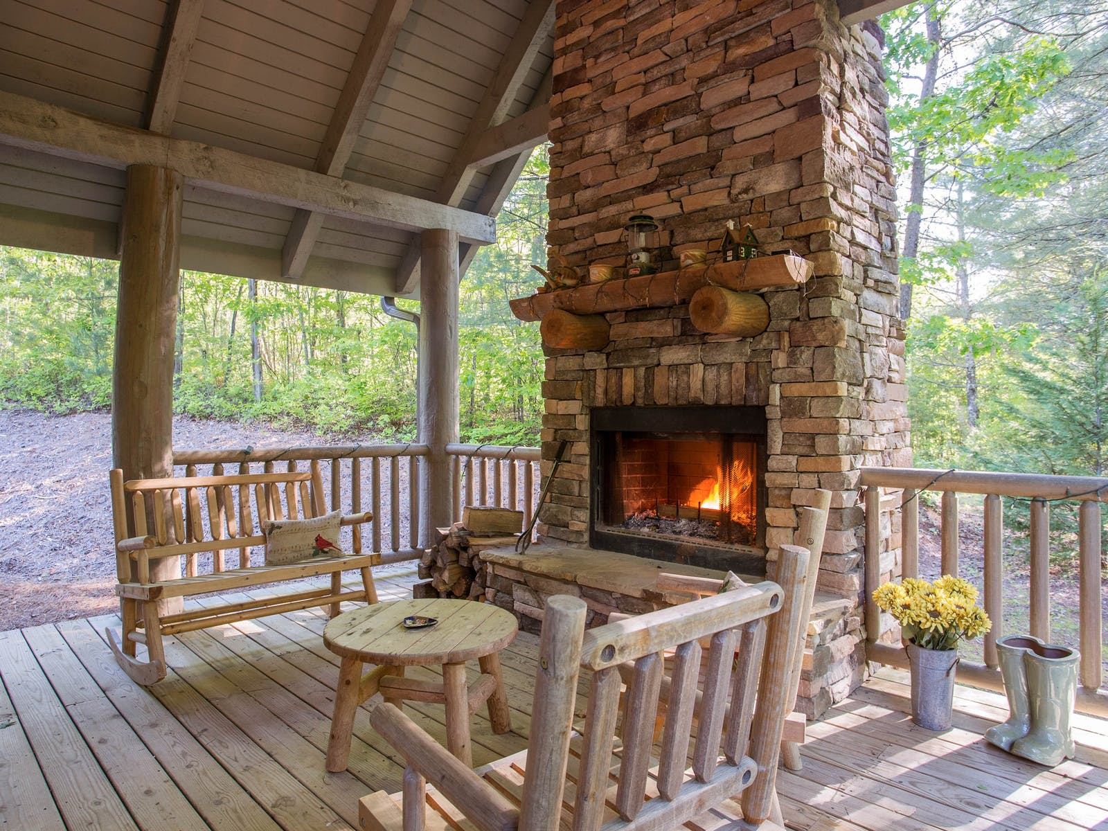 outdoor stone fireplace of blue ridge mountains vacation cabin