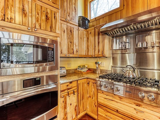 gourmet kitchen with beautiful stainless steel appliances