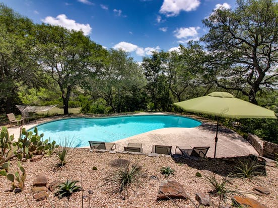Outdoor pool located in Dripping Springs, TX