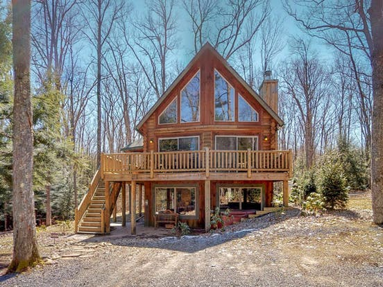 two-story mountain cabin in oakland, md with large balcony and outdoor hot tub