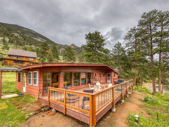 Riverfront cabin exterior and back deck in Colorado