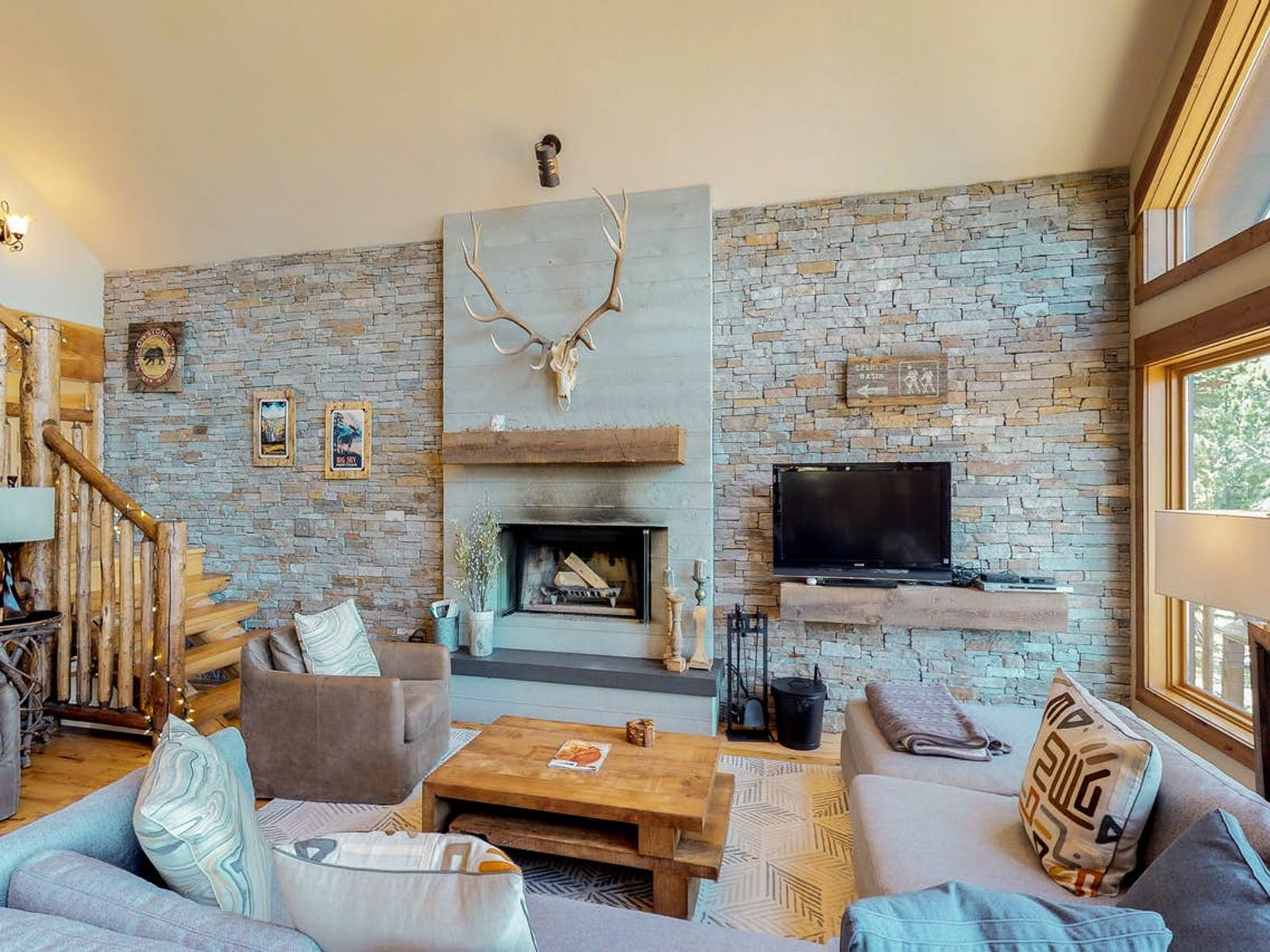wood burning fireplace with a stag head mounted above in Big Sky, MT vacation home