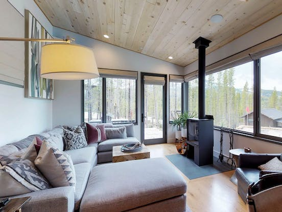 Vacation rental living area with fireplace in Yellowstone