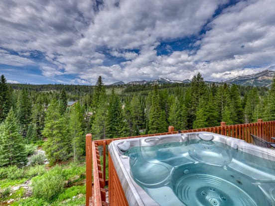 Riverfront cabin hot tub overlooking forest in Colorado