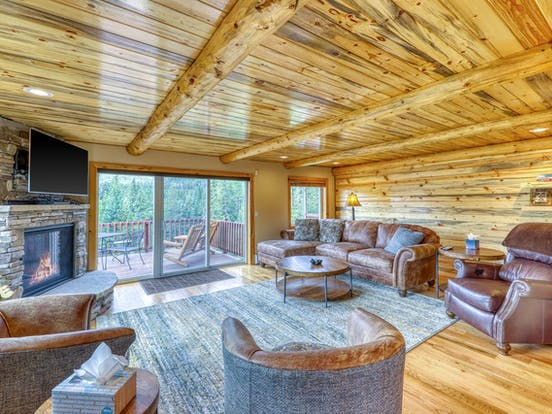 Riverfront cabin living area and deck in Colorado