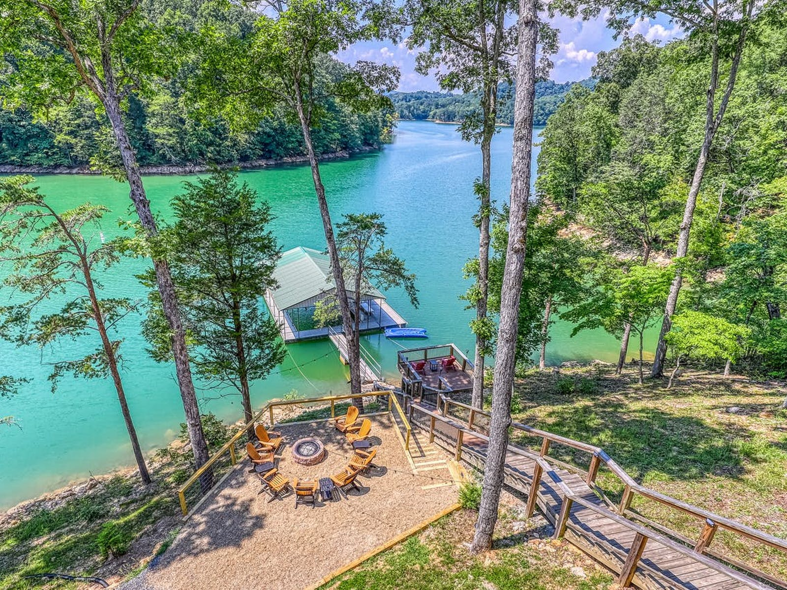 waterfront vacation rental on Norris Lake with boat dock and firepit