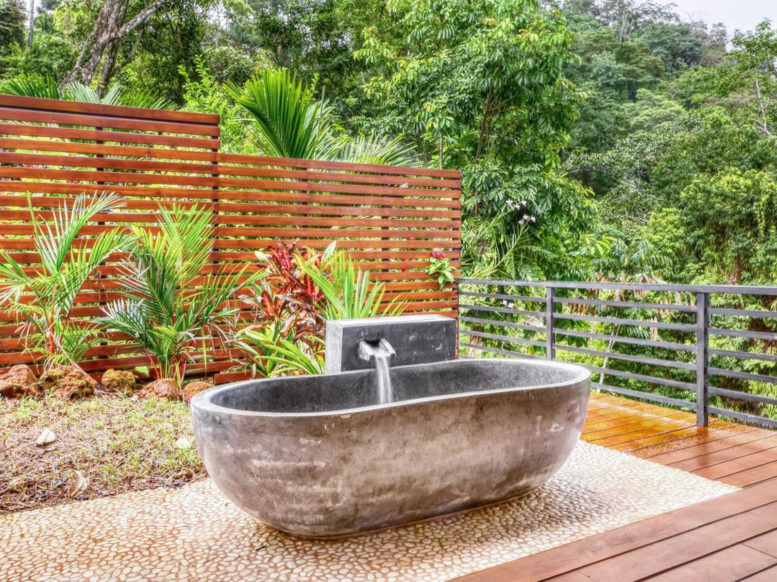 one-of-a-kind bathtub made from carved rock
