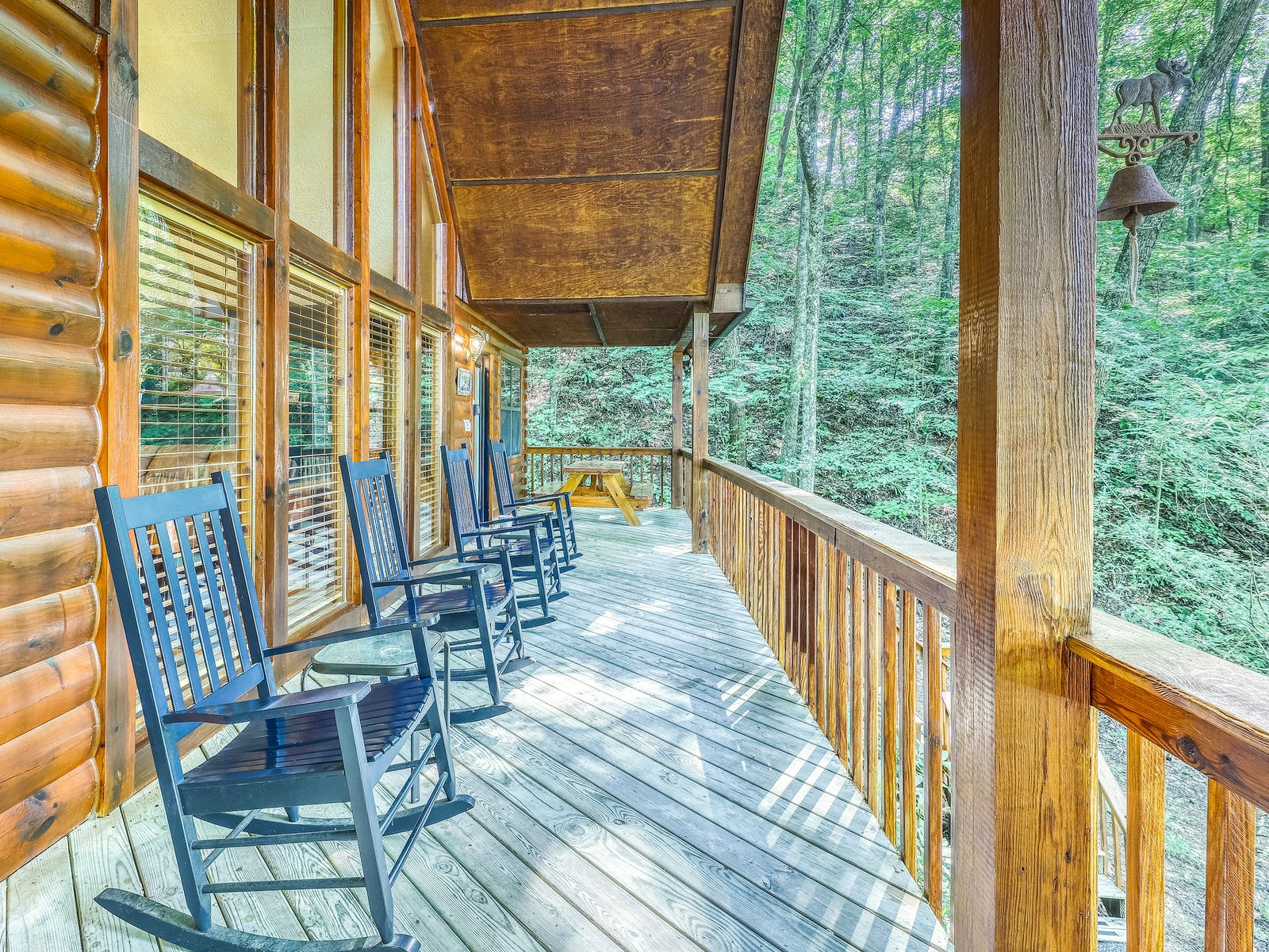 Vacation rental porch in Pigeon Forge, TN with views of the surrounding woods