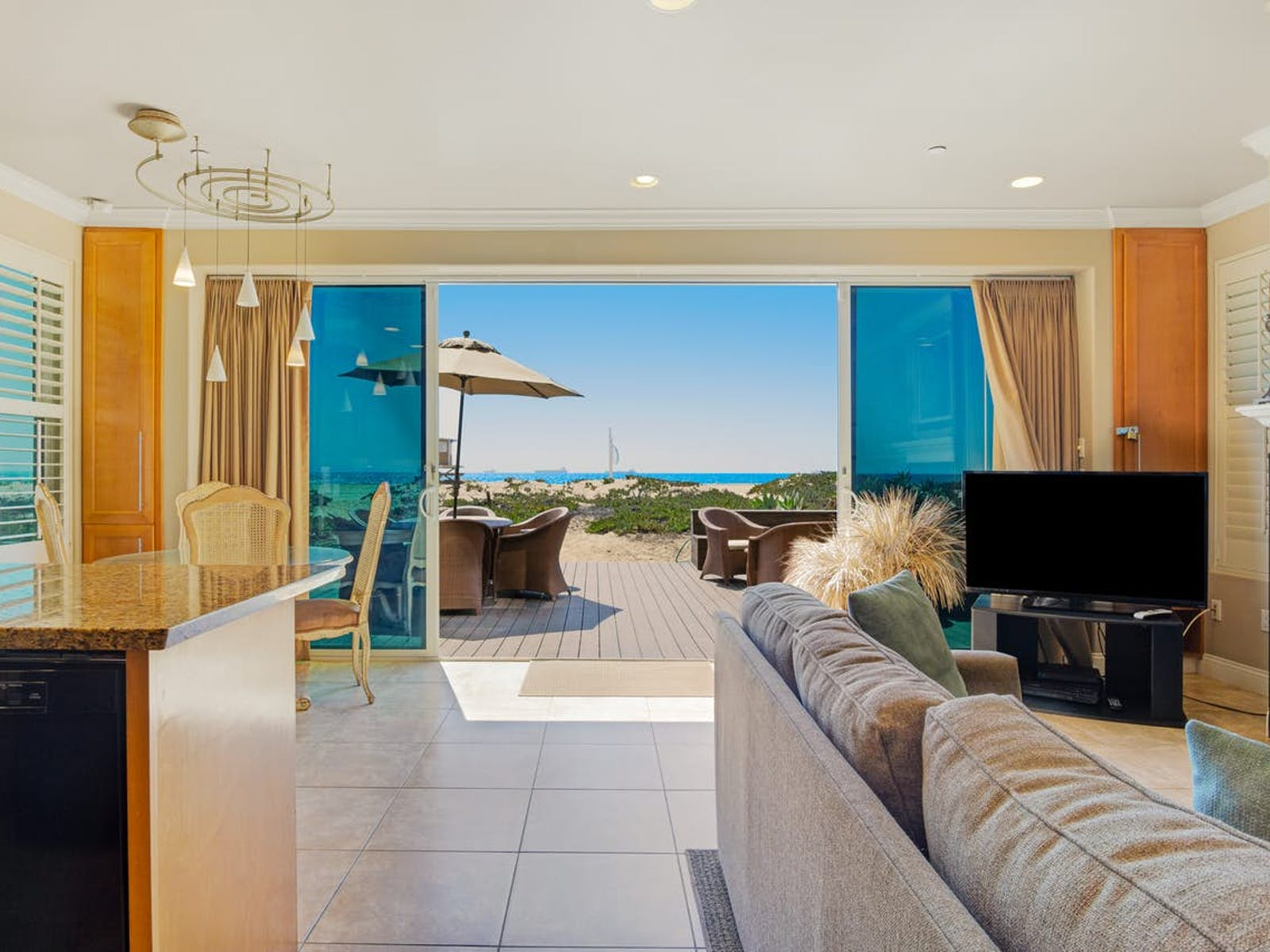 Vacation rental living area and back porch in Sunset Beach, CA