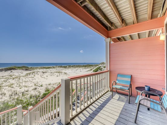 View from back porch of waterfront vacation rental with views of the beach