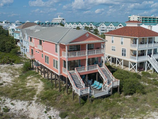 Waterfront vacation rental exterior next to the beach
