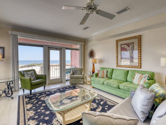 Waterfront vacation rental living room with views of the beach