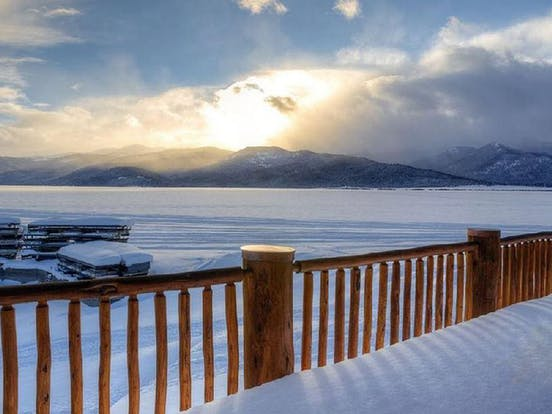 gorgeous snowy mountain view from deck of west yellowstone vacation rental