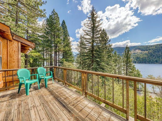 two plastic chairs face Donner Lake on deck of vacation rental