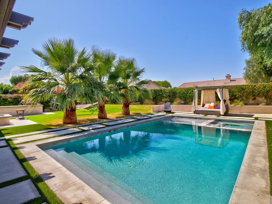 Outdoor pool with cabana at Indio vacation rental