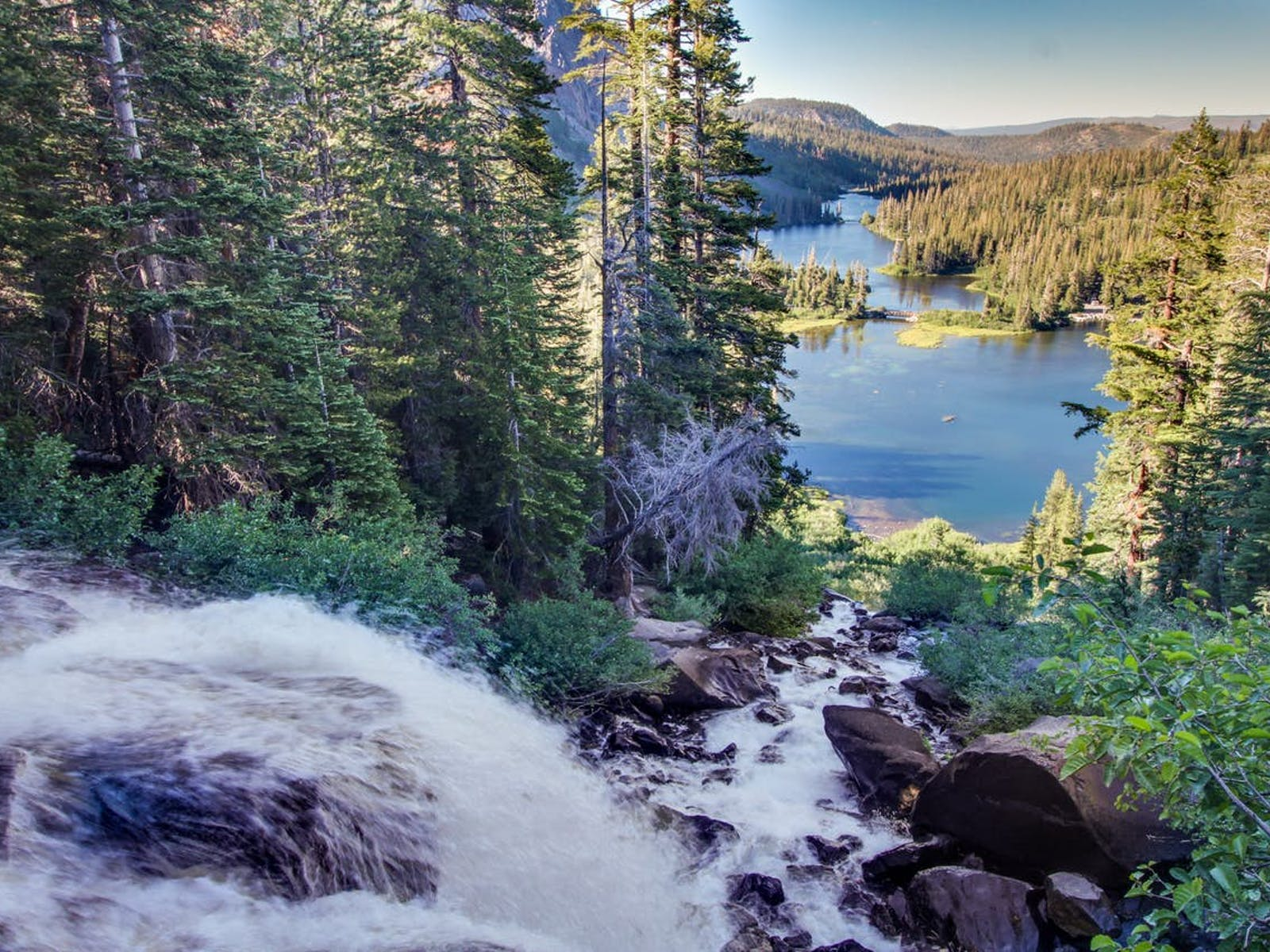 waterfall rushing into lake in mammoth lakes, ca