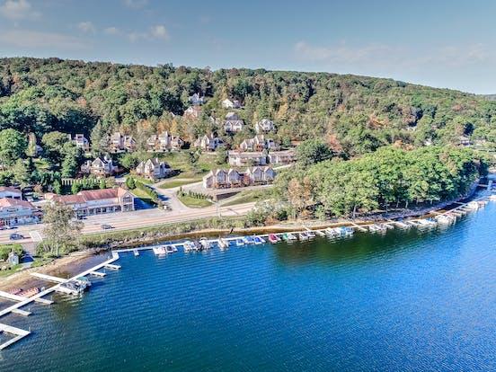 deep creek lake lakefront with docks and boats