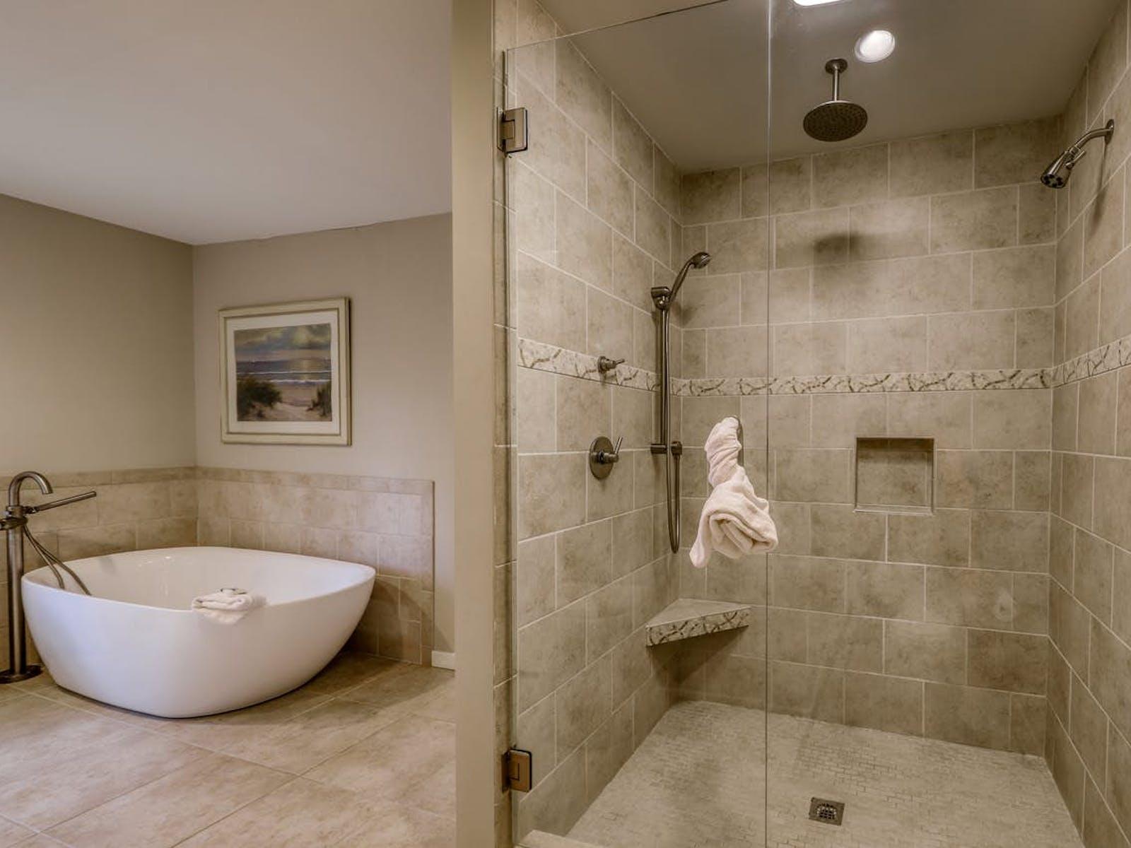 neutral-hued bathroom features a rare square bathtub next to a dual-head shower