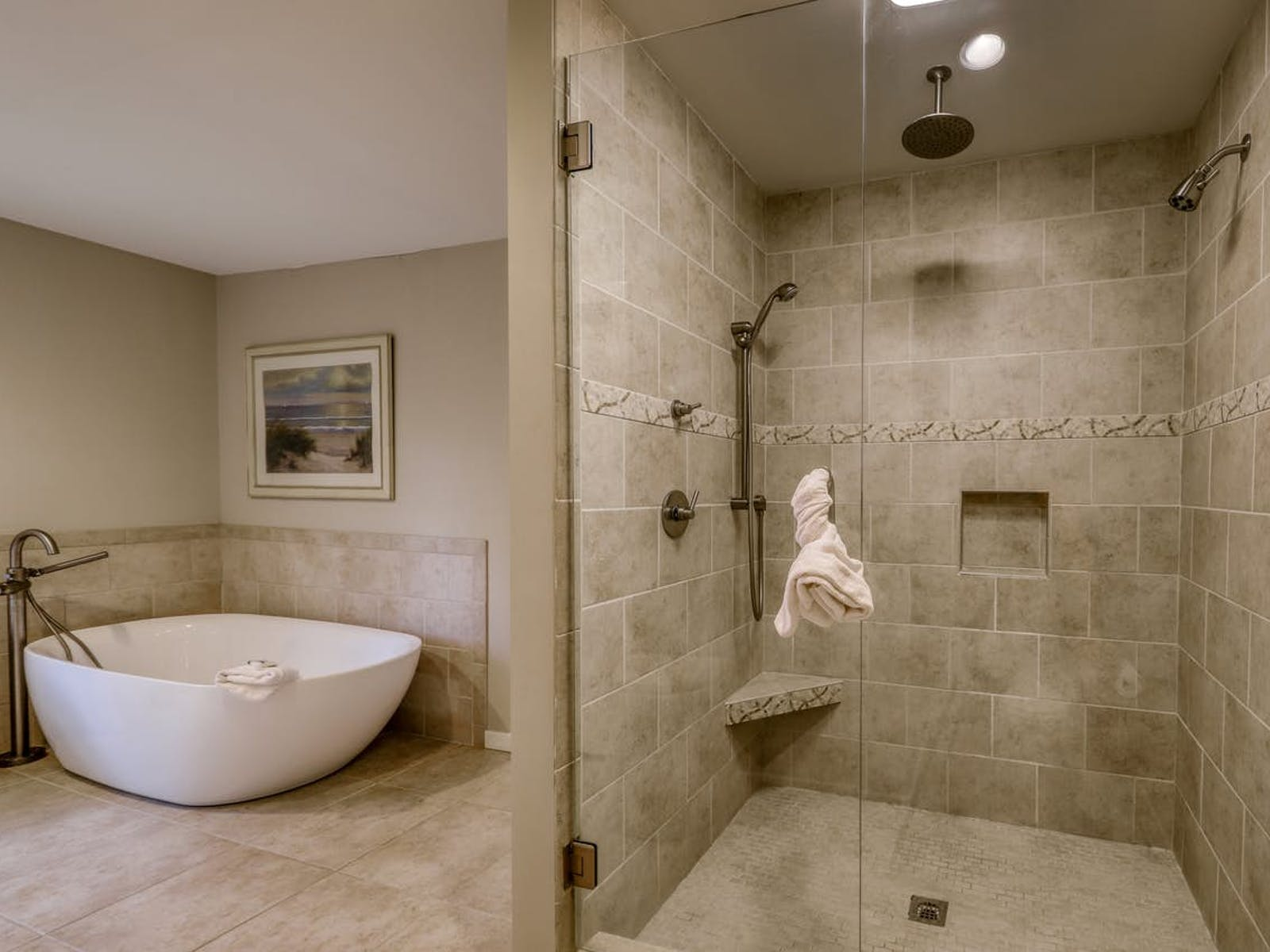 neutral-hued bathroom features a rare square bathtub next to a dual-head shower