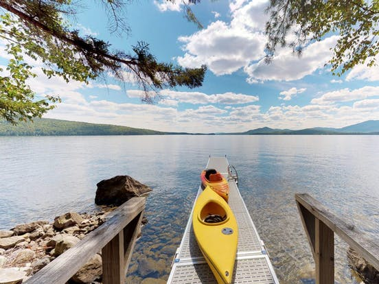 two kayaks sit atop a boat dock in Greenville, ME