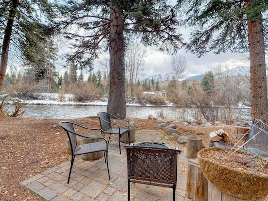 Riverfront cabin back patio in Colorado