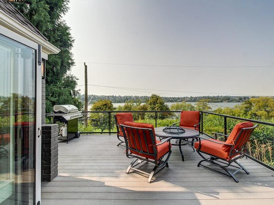 Seattle waterfront vacation rental deck with grill and dining accommodations