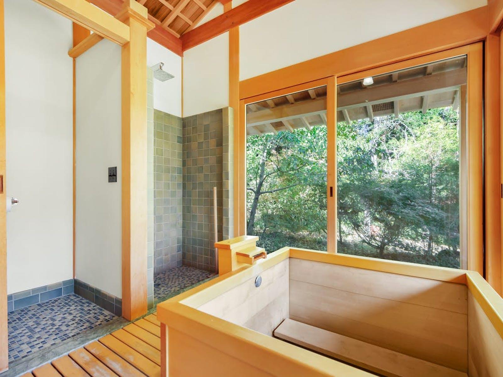 a traditional Japanese tea and bath house that includes a cedar soaking tub