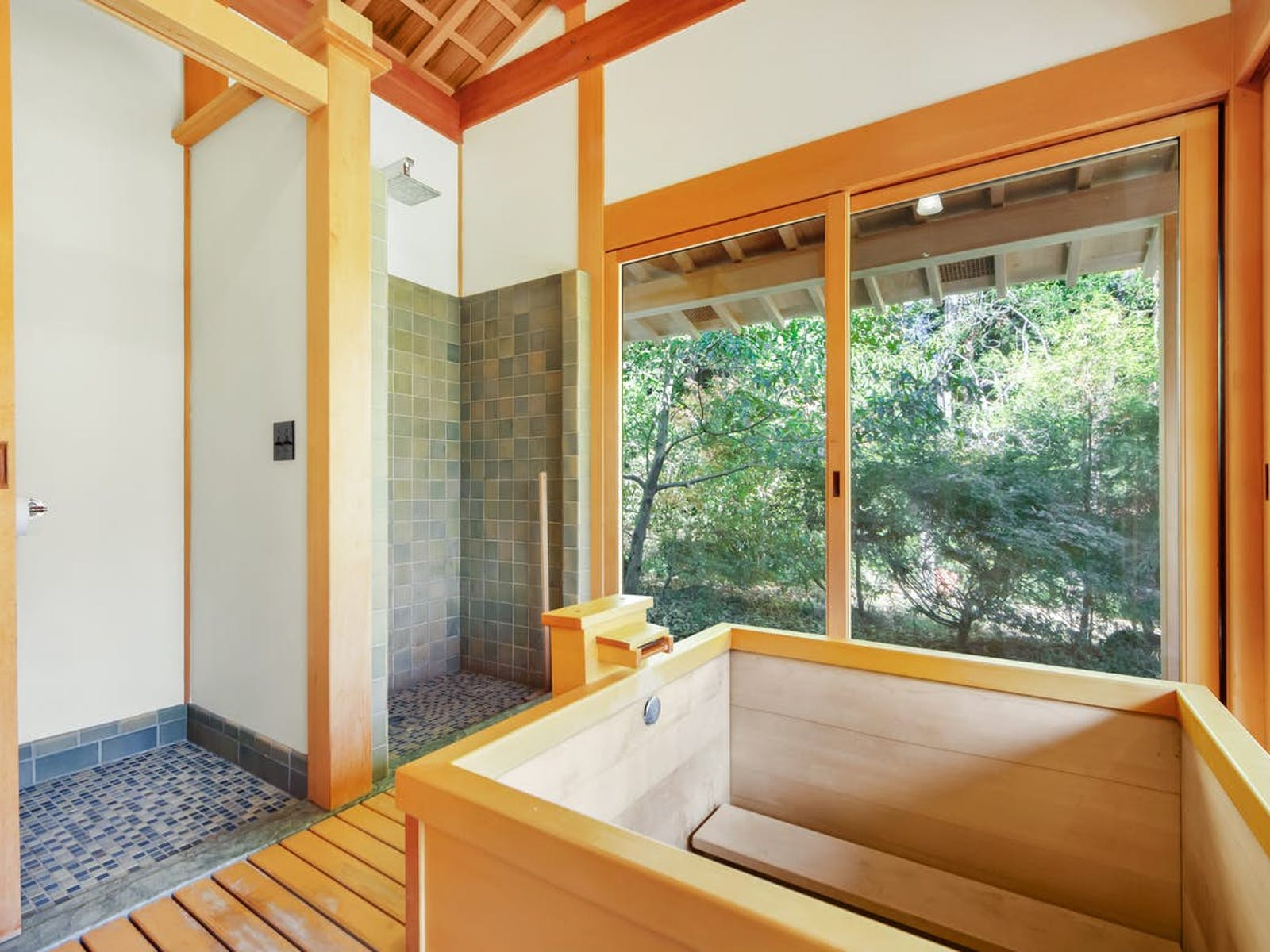a traditional Japanese tea and bath house that includes a cedar soaking tub