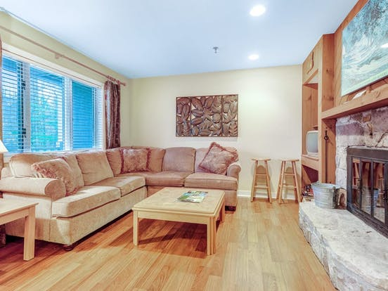living area offers plenty of seating plus a wood-burning fireplace