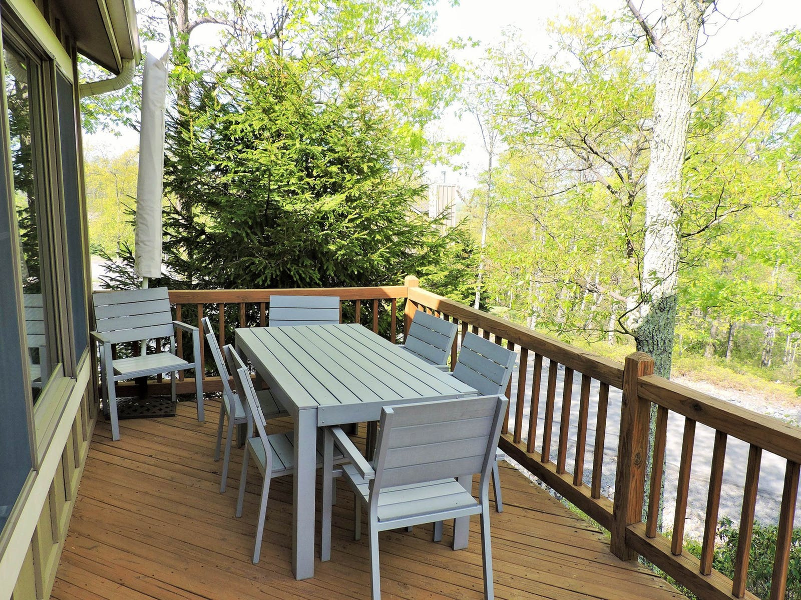 Vacation rental deck in Tannersville, PA with views of the forest