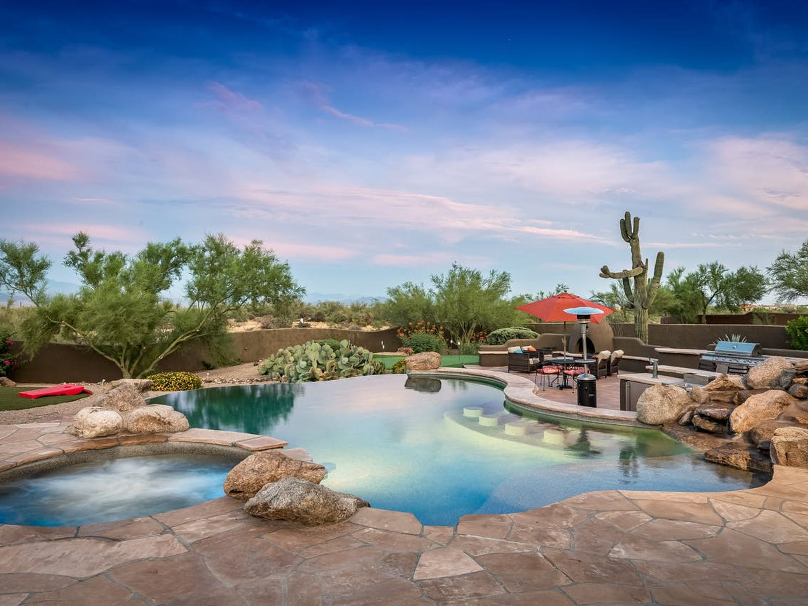 desert oasis vacation rental with beautifully landscaped infinity pool