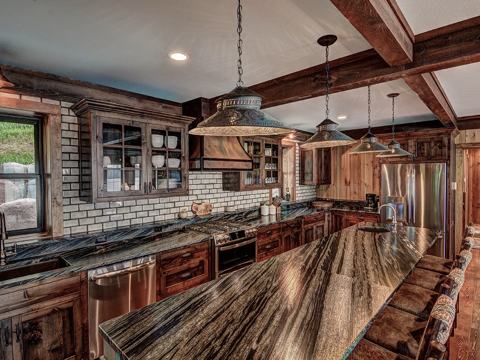 kitchen with wood-paneled walls, granite countertops, and wool-upholstered chairs
