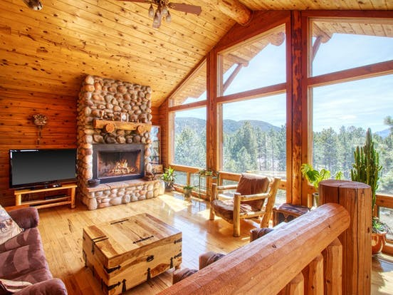 stone fireplace inside colorado cabin