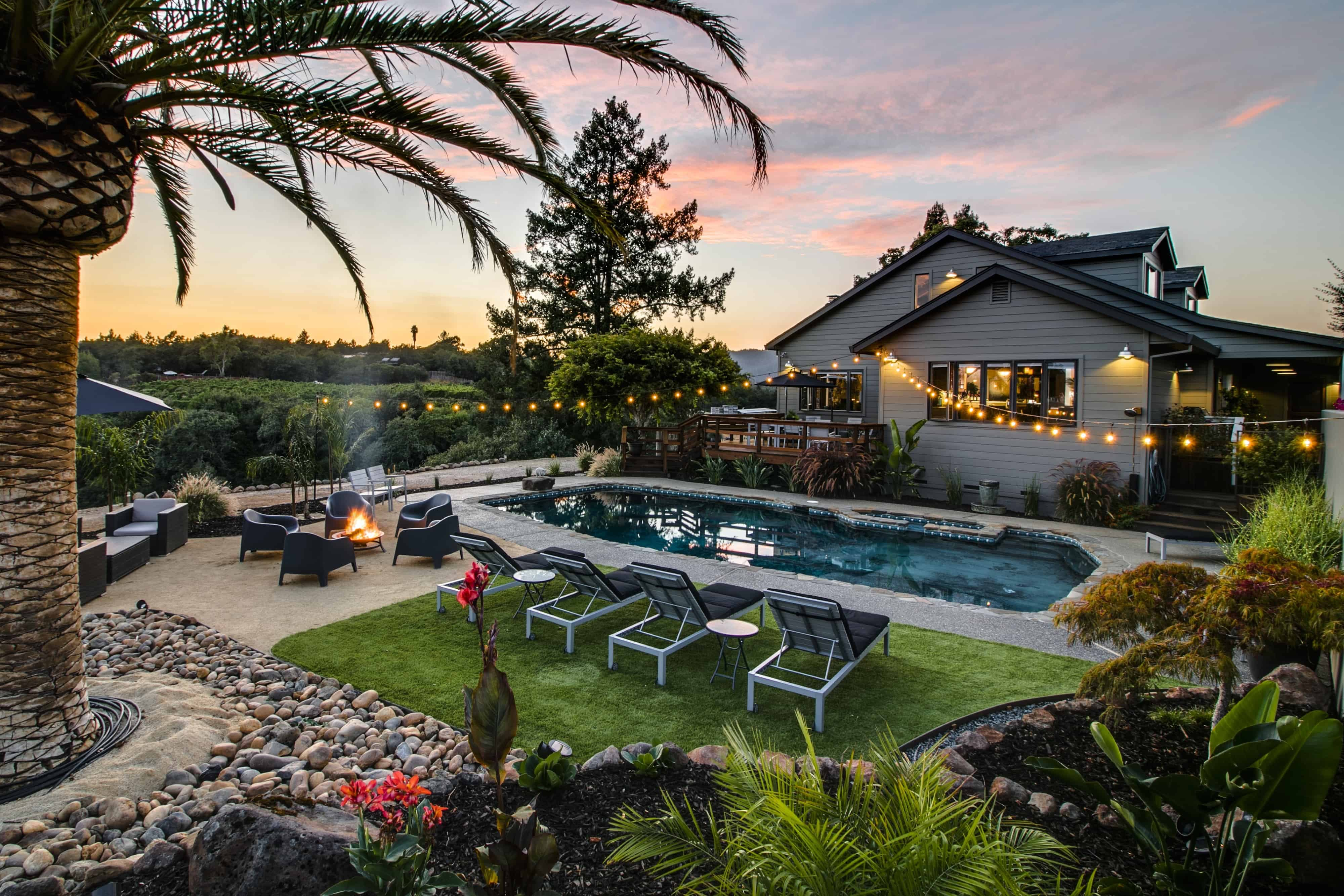 a pool and lawn outside of a california vacation home