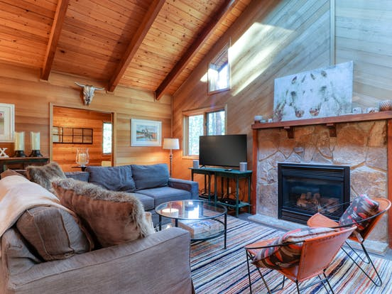 interior of black butte, or cabin rental with stone fireplace