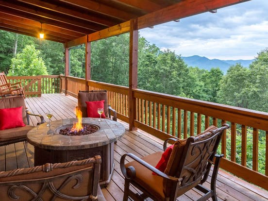 outdoor firepit on deck of Sylva, NC cabin with beautiful mountain views