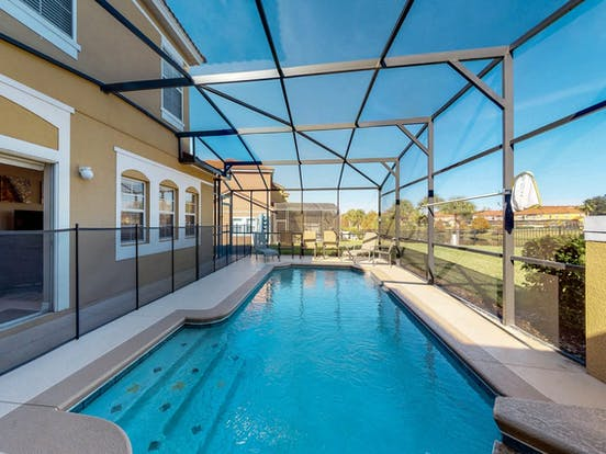 Enclosed outdoor pool with patio seating located in Kissimmee, FL