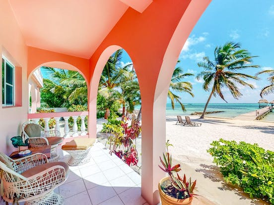 colorful Ambergris Caye condo right on the beach