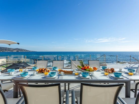 outdoor dining table of seaside home in the French Riviera